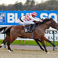 Spellmaker and William Carson winning the 2.35 race
