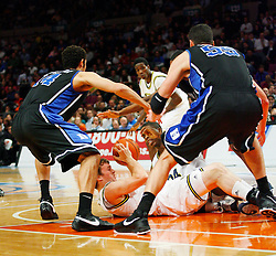 Nov 21, 2008; New York, NY, USA; Players from the Duke Blue Devils and Michigan Wolverines battle for a loose ball during the 2K Sports Classic Championship game at Madison Square Garden.