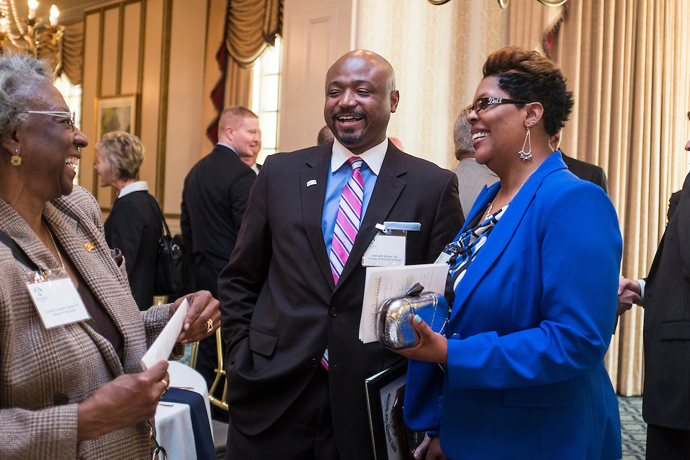 Kenneth N. Wilson and his wife DeShawna share a laugh with well-wisher Connie Lawson-Davis following the State Government Alumni Luncheon on Tuesday, May 5, 2015.  Photo by Ohio University  /  Rob Hardin