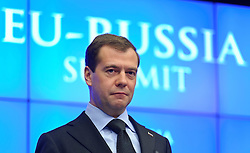 "Dmitry Medvedev, Russia's president, pauses during a press conference following the EU-Russia summit at the European Union council headquarters in Brussels, Belgium, on Tuesday, Dec. 7, 2010. Russia will move a step closer to membership in the World Trade Organisation today when it signs an agreement with the European Union settling ""key questions"" that have hampered its accession bid for years. (Photo © Jock Fistick)."