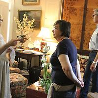 Greta Raigins, left, shows off a room at Lenior Cottage.