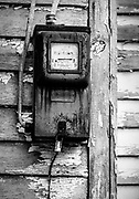 An old meter box on the side of an old abandoned country store on Hwy 158 near Reidsville, NC.