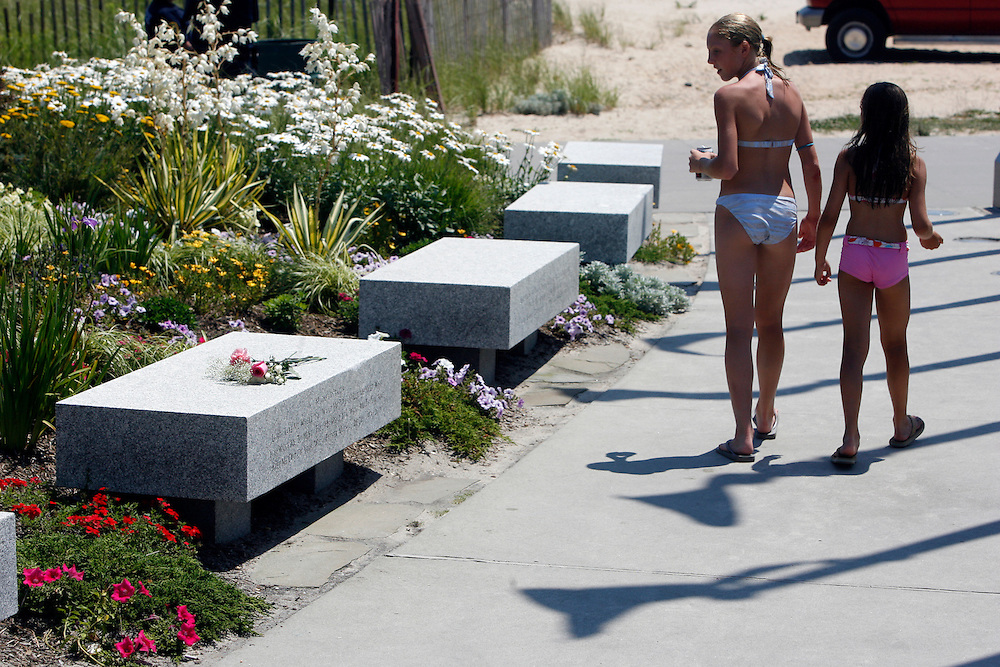 Two young girls walk through the TWA Flight 800 Memorial  before ceremonies marking the 10th anniversary of the disaster at Smith Point Park in Shirley, New York, Monday 17 July 2006