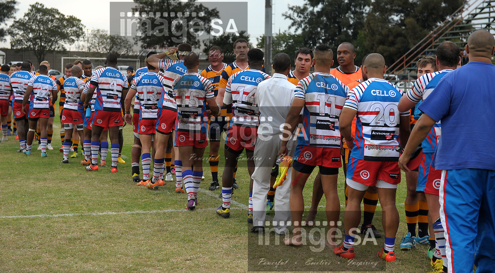 JOHANNESBURG, SOUTH AFRICA - Saturday 14 March 2015, Players greet after the fourth round match of the Cell C Community Cup between Raiders and Pretoria Police at the Bill Jardine stadium.<br /> Photo by ImageSA/SARU