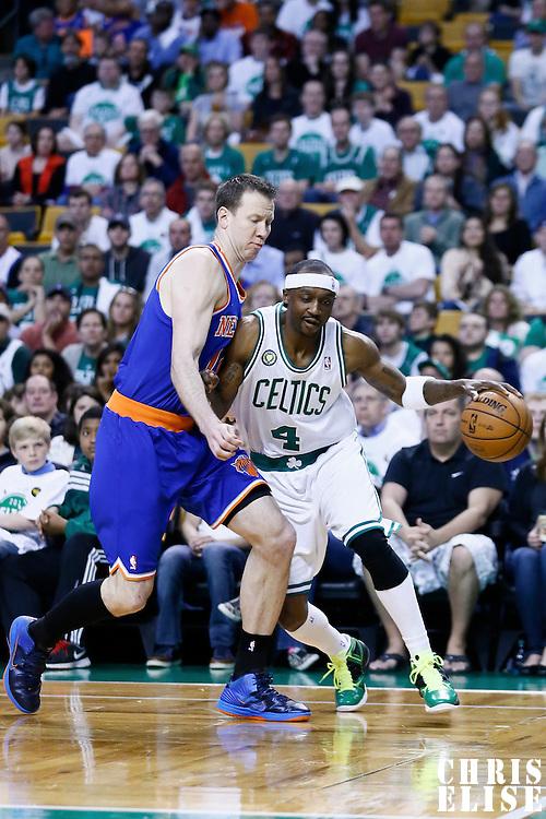 28 April 2013: Boston Celtics shooting guard Jason Terry (4) drives past New York Knicks small forward Steve Novak (16) during Boston Celtics overtime 97-90 victory over the New York Knicks during Game Four of the Eastern Conference Quarterfinals of the 2013 NBA Playoffs at the TD Garden, Boston, Massachusetts, USA.