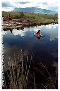Kanavayen, Venezuela 030405   A tourist takes a dip at a waterhole on the edges of Roraima National Park in Venezuela. (Essdras M Suarez/ Globe Staff)