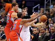 Dec. 23, 2012; Phoenix, AZ, USA; Phoenix Suns guard Goran Dragic (1) is guarded by the Los Angeles Clippers forward Blake Griffin (32) and guard Chris Paul (3) in the first half at US Airways Center. The Clippers defeated the Suns 103-77. Mandatory Credit: Jennifer Stewart-USA TODAY Sports