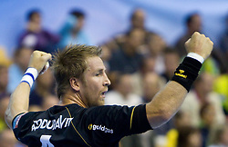 Oliver Roggisch (#4) of RNL celebrates during Velux EHL Champions league 2010/2011 Group A men handball match between HC Celje Pivovarna Lasko of Slovenia and Rhein-Neckar Loewen of Germany, on October 2, 2010 in Arena Zlatorog, Celje, Slovenia. Rhein-Neckar Löwen defeated Celje Pivovarna Lasko 32 - 28. (Photo By Vid Ponikvar / Sportida.com)