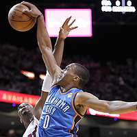 19 June 2012: Oklahoma City Thunder point guard Russell Westbrook (0) goes for the dunk over Miami Heat power forward Chris Bosh (1) during the first quarter of Game 4 of the 2012 NBA Finals, Thunder at Heat, at the AmericanAirlinesArena, Miami, Florida, USA.