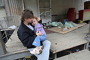 Candy Lumpkins with her daughter Amy outside their trailer home. The Lumpkins, deep in poverty, live in the Appalachian Mountains in Eastern Kentucky near the town of Mousie.