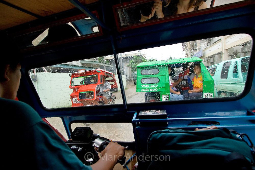 A view from inside a tricycle, Tagbilaran, Bohol, Philippines..