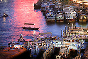 Abras and dhows on the Dubai Creek at sunset.