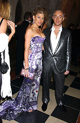 Fashion designer SCOTT HENSHALL and HOFIT GOLAN at Andy & Patti Wong's annual Chinese New Year party, this year celebrating the year of the dog held at The Royal Courts of Justice, The Strand, London WC2 on 28th January 2006.<br /><br />NON EXCLUSIVE - WORLD RIGHTS