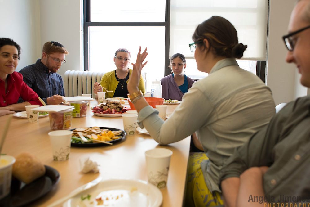 Students hold a lunch honoring Ruth Balinsky Friedman (Class of 2013), third from left, and Rori Picker Neiss (Class of 2014), third from right, both of whom are leaving the school this year for professional clergy positions. Friedman, who is graduating, has a placement with a synagogue in Washington D.C.. Neiss, who will complete her last year of study remotely, has a placement with a synagogue in St. Louis, Missouri. <br /> <br /> Also pictured from left, Dr. Anat Sharbat (Class of 2015), Friedman's husband Yoni Friedman, Ramie Smith (Class of 2016) who is talking to them about the effect they have had on her, and Neiss' husband Russel Neiss. <br /> <br /> The female students of Yeshivat Maharat, &quot;the first institution to train Orthodox women as spiritual leaders and halakhic authorities,&quot; study at the Drisha Institute in New York City in preparation for the school's inaugural graduation on June 16, 2013. <br /> <br /> Three women will be the first to graduate from the four-year school and will be given the title &quot;Maharat&quot;, a Hebrew acronym for &quot;Manhiga Hilkhatit Rukhanit Toranit&quot; which translates to a teacher of Jewish law and spirituality.The school, which currently has 14 students, was founded by Rabbi Avi Weiss. Rabbi Wiess controversially ordained the first female Orthodox Rabba in history, Rabba Sara Hurwitz, who serves as the dean of the school. <br /> <br /> <br /> Photo by Angela Jimenez <br /> www.angelajimenezphotography.com