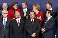 (From L-R 1st row) European Council President Herman Van Rompuy, Romanian President Traian Basescu, Cyprus President Nicos Anastasiades, European Commission President Jose Manuel Barroso, (2nd row) Czech Prime Minister Jiri Rusnok, Slovenian Prime Minister Alenka Bratusek, Portuguese Prime Minister Pedro Passos Coelho , German Chancellor Angela Merkel andFinnish Prime Minister Jyrki Katainen pose for a family photo during an European Union summit in Brussels, Belgium, 24 October 2013.