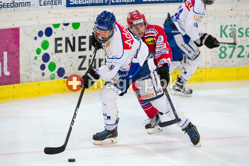 (L-R) ZSC Lions defenseman Samuel Julius Fischer fights for the puck against Rapperswil-Jona Lakers forward Toni Szabo during the fifth Elite B Playoff Final ice hockey game between Rapperswil-Jona Lakers and ZSC Lions held at the SGKB Arena in Rapperswil, Switzerland, Sunday, Mar. 19, 2017. (Photo by Patrick B. Kraemer / MAGICPBK)