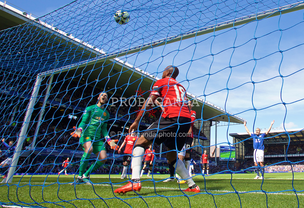 LIVERPOOL, ENGLAND - Sunday, April 26, 2015: Manchester United's goalkeeper David de Gea and Ashley Young look dejected as Everton's John Stones scores the second goal during the Premier League match at Goodison Park. (Pic by David Rawcliffe/Propaganda)