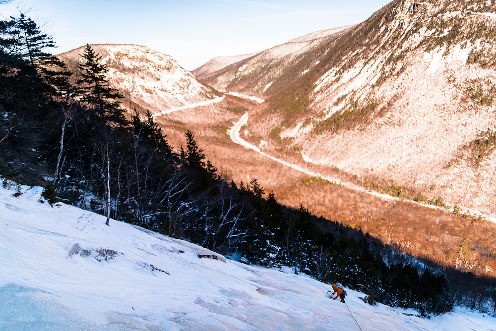 AMC Student climbing the Willey Slides looking into Crawford Notch