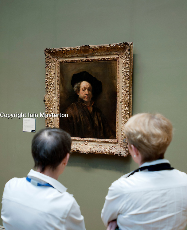 Visitors looking at Self portrait by Rembrandt van Rijn at Metropolitan Museum of Art in Manhattan , New York City, USA