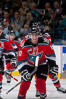 KELOWNA, CANADA - OCTOBER 4:  Nick Merkley #10 of the Kelowna Rockets is all smiles after scoring a goal against the Portland Winterhawks  at the Kelowna Rockets on October 4, 2013 at Prospera Place in Kelowna, British Columbia, Canada (Photo by Marissa Baecker/Shoot the Breeze) *** Local Caption ***