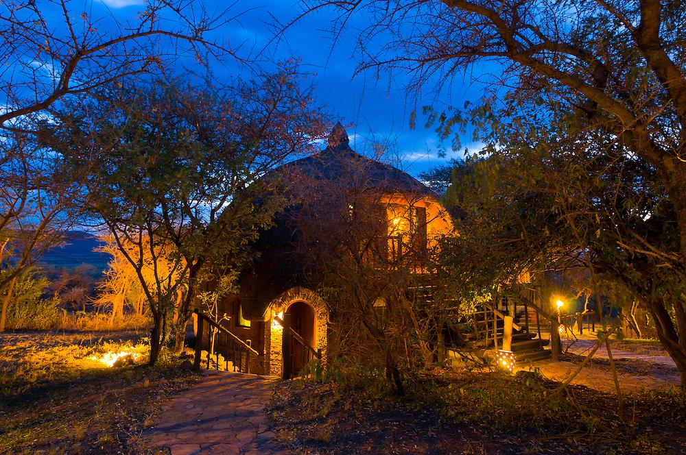 Twilight view of a boma (guest cottage), Serengeti Serena Lodge, Serengeti National Park, Tanzania