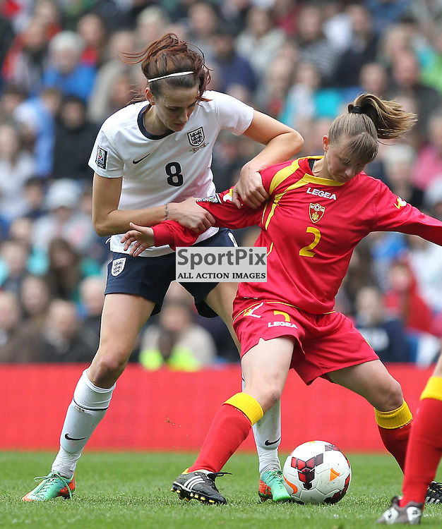England's Jill Scott battles with Montenegro's Zeljka Radanovic during the FIFA Women's World Cup qualifier match between England and Montenegro at the American Express Community Stadium, Brighton, 5th April 2014 © Phil Duncan | SportPix.org.uk