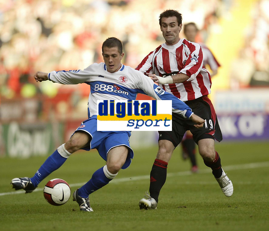 Photo: Aidan Ellis.<br /> Sheffield United v Middlesbrough. The Barclays Premiership. 30/09/2006.<br /> Boro's Andrew Taylor comes under pressure from Sheffield's Keith Gillespie