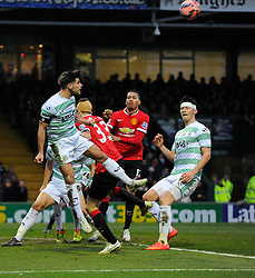 Yeovil Town's Joe Edwards heads clear  - Photo mandatory by-line: Joe meredith/JMP - Mobile: 07966 386802 - 04/01/2015 - SPORT - football - Yeovil - Huish Park - Yeovil Town v Manchester United - FA Cup - Third Round
