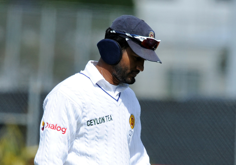 Sri Lanka's Dimuth Karunaratne wears ear warmers while fielding in the skips against New Zealand on day four of the first International Cricket Test, University Cricket Oval, Dunedin, New Zealand, Sunday, December 13, 2015.Credit:SNPA / Ross Setford
