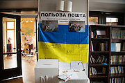 Ukrainski Swiat (Ukrainian World) museum and community center. A flag signed by units fighting in Eastern Ukraine in front of a postbox for letters for soldiers.