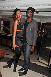 TOLULA ADEYEMI and stylist MASON SMILLIE at a party hosted by TopShop to celebrate 10 years of NEWGEN and 10 years of supporting Brtish Fashion held at Le Baron, 29 Old Burlington Street, London W1 on 21st February 2012.