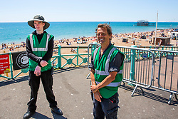 © Licensed to London News Pictures. 31/05/2020. Brighton, UK. Brighton and Hove council officers are managing the entrance to the beach as hot and sunny weather is hitting the seaside resort. Photo credit: Hugo Michiels/LNP