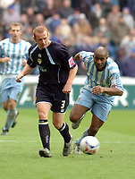 Photo: Leigh Quinnell.<br /> Coventry City v Leeds United. Coca Cola Championship. 18/03/2006. Leeds' Stephen Crainey passes the ball away from Coventrys Dele Adebola.