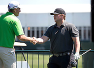 Pro golfer Greg Owen meets Houston Texans Jon Weeks on the first tee box at the Golf Club of Houston on Monday, March 28, 2016 in Humble, TX. (Photo: Thomas B. Shea/For the Chronicle)