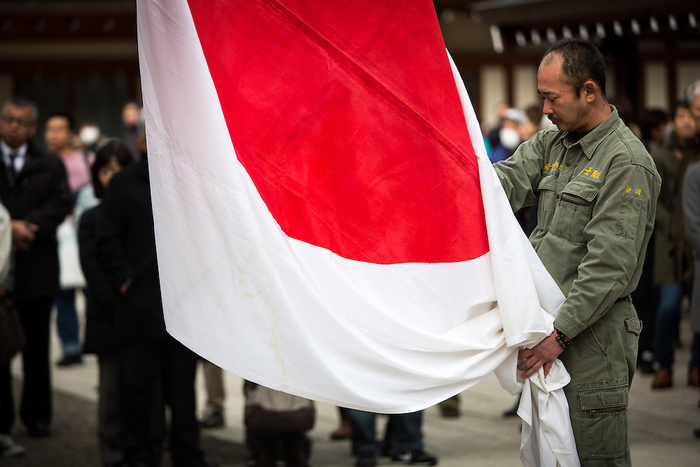 TOKYO, JAPAN - FEBRUARY 11 : Nationalist group members is seen in front of Yasukuni Shrine with a Japanese flag during a ceremony to commemorate to the souls of those who have died in the service of Japan, marking the National Foundation Day, Saturday, Feb. 11, 2017. (Photo by Richard Atrero de Guzman/NURPhoto)