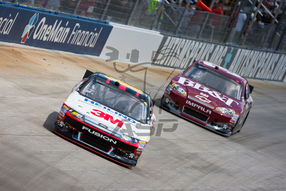 DOVER, DE - JUN 03, 2012:  Greg Biffle (16) races during the FedEx 400 Benefiting Autism Speaks at the Dover International Speedway in Dover, DE.