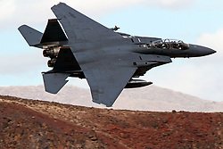 McDonnell-Douglas F-15E Strike Eagle from the United States Air Force 4th Fighter Wing, Seymour Johnson Air Force Base, North Carolina, flies low level through the Jedi Transition Star Wars Canyon, Death Valley National Park, California, United States of America