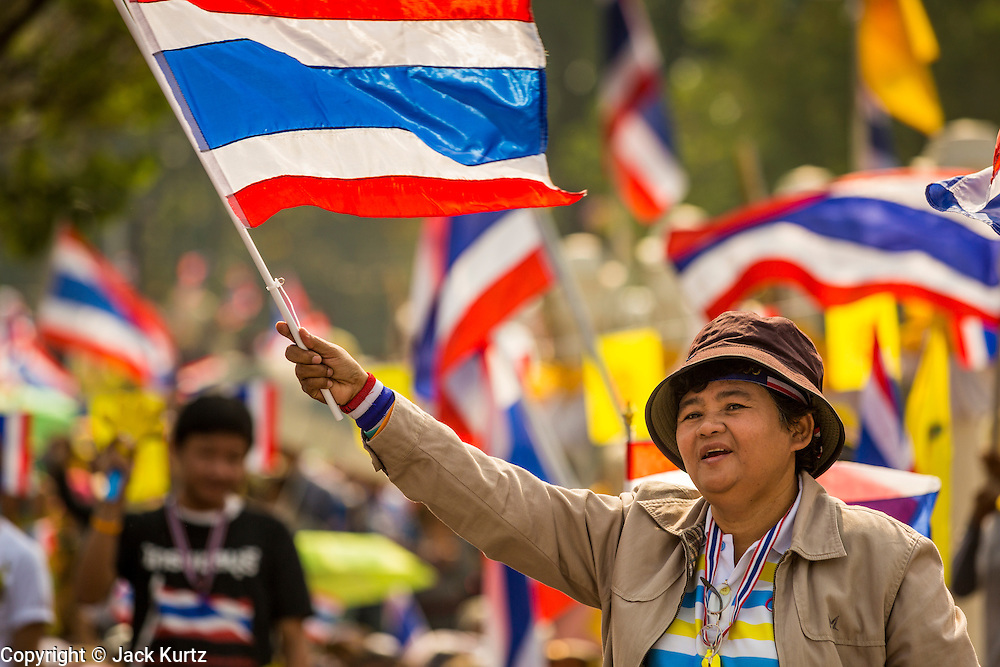 """09 DECEMBER 2013 - BANGKOK, THAILAND: Thai anti-government protestors celebrate the news that Prime Minister Yingluck Shinawatra dissolved the Thai parliament. Thai Prime Minister Yingluck Shinawatra announced she would dissolve the lower house of the Parliament and call new elections in the face of ongoing anti-government protests in Bangkok. Hundreds of thousands of people flocked to Government House, the office of the Prime Minister, Monday to celebrate the collapse of the government after Yingluck made her announcement. Former Deputy Prime Minister Suthep Thaugsuban, the organizer of the protests, said the protests would continue until the """"Thaksin influence is uprooted from Thailand."""" There were no reports of violence in the protests Monday.      PHOTO BY JACK KURTZ"""