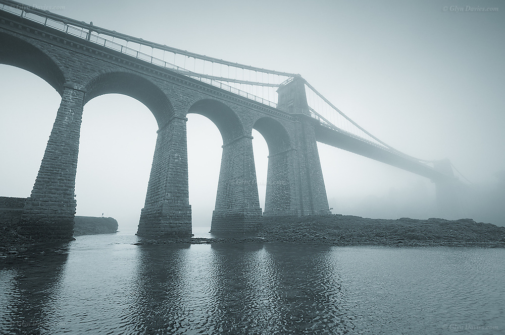 A year and a half on from my March Mist Series 2003, the Menai Suspension Bridge was once again shrouded in heavy mist. I was down at the water's edge at breakfast time and it was warm but quite eerie. From this angle, it was hard to see any of the pre rush hour traffic and in the silence, I was able to consider just how old and beautiful this bridge is, and the events and people in history that it's witnessed.