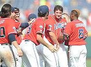 Mississippi's John Gatlin (36) is mobbed by teammates following his game winning hit against Texas Tech at T.D. Ameritrade Park in the College World Series in Omaha, Neb. on Tuesday, June 17, 2014. Ole Miss won 2-1.