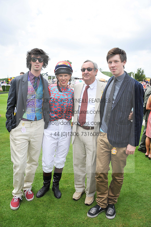 NICK & NETTE MASON with their sons, left GUY MASON and right CARY MASON at the 3rd day of the 2011 Glorious Goodwood Racing Festival - Ladies Day at Goodwood Racecourse, West Sussex on 28th July 2011.