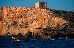MALTA COMINO JUL00 - A traditional Maltese fishing boat, a 'Daisa' sails past the lighting point at Comino Island.. . jre/Photo by Jiri Rezac. . © Jiri Rezac 2000. . Tel:   +44 (0) 7050 110 417. Email: info@jirirezac.com. Web:   www.jirirezac.com