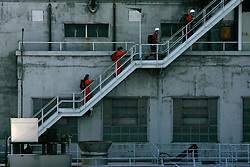 "ITALY GENOA 26OCT08 - Activists entered Enel's power plant in Genoa, and Greenpeace climbers hung a banner from Genoa's landmark ""Torre della Lanterna"" lighthouse...Greenpeace called on the energy company Enel to shut down its coal-fired power plant in Genoa, the capital of the Liguria region of Italy, in a series of actions this morning. Enel is persisting in keeping the plant open, despite demands by the Ligurian regional government to shut it down immediately...jre/Photo by Jiri Rezac / GREENPEACE"