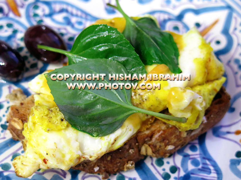 Basil cheese omelet with toasted bread and olives - Middle Eastern Food.