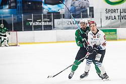 Blaz Tomazevic of HDD Sij Acroni Jesenice and Koren Gal of HK SZ Olimpija during ice hockey match between HK SZ Olimpija and HDD Sij Acroni Jesenice in 1. Round of Playoff  in Alps Hockey League 2019/20, on February 13, 2020, in Hala Tivoli, Ljubljana, Slovenia. Photo By Grega Valancic / Sportida