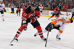 Jan 21; Newark, NJ, USA; New Jersey Devils left wing Ilya Kovalchuk (17) takes a shot while Philadelphia Flyers defenseman Erik Gustafsson (26) defends during the third period at the Prudential Center. The Flyers defeated the Devils 4-1.