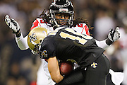 NEW ORLEANS, LA - DECEMBER 26:   Lance Moore #16 of the New Orleans Saints is tackled by Dunta Robinson #23 of the Atlanta Falcons at Mercedes-Benz Superdome on December 26, 2011 in New Orleans, Louisiana.  The Saints defeated the Falcons 45-16.  (Photo by Wesley Hitt/Getty Images) *** Local Caption *** Lance Moore; Dunta Robinson