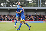 Callum Kennedy defender for AFC Wimbledon (3) celebrates with Lyle Taylor forward for AFC Wimbledon (33) after he scores to make it 1-0 during the Sky Bet League 2 match between AFC Wimbledon and Leyton Orient at the Cherry Red Records Stadium, Kingston, England on 23 April 2016. Photo by Stuart Butcher.