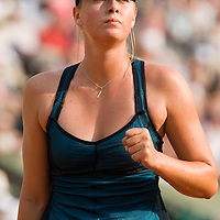 03 June 2007: Russian player Maria Sharapova pumps his fist during the French Tennis Open fourth round match, won 3-6, 6-4, 9-7 by Maria Sharapova against Patty Schnyder, on day 8 at Roland Garros, in Paris, France.