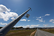 A tsunami damaged  telegraph pole on in the town of Tomioka, Futaba District of Fukushima, Japan. Thursday May 2nd 2013. The town was evacuated on March 12th after the March 11th 2011 earthquake and tsunami cause meltdowns at the nearby Fukushima Daichi nuclear power station. It lies well within the 20 kms exclusion zone though parts of the town were opened in spring 2013 again to allow locals to visit their property during daylight hours.
